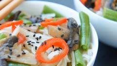 Roasted teriyaki mushrooms and asparagus soba noodles Stock Footage