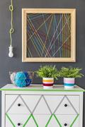 Commode with handmade wool decoration Stock Photos