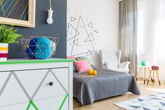 Modern bedroom with commode Stock Photos