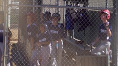A boys coach and team at a little league baseball game. Stock Footage