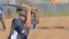 A batter makes a base hit while playing in a boys little league baseball game. Stock Footage