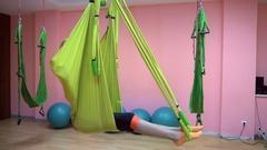 Yogi practice aerial anti gravity yoga on a hammock Stock Footage