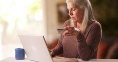 Caucasian mid aged woman making an online purchase Stock Footage