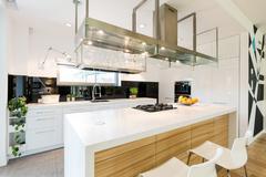 Loft kitchen with large worktop Stock Photos
