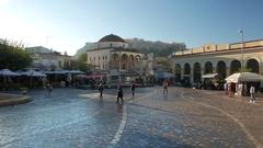 4K Commuters at Monastiraki Metro square Tsisdarakis Mosque and Acropolis Athens Stock Footage
