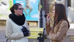 Two young women talking on the street Stock Footage