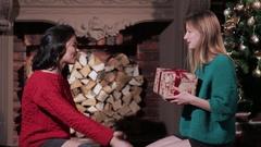 Two foolish girlfriends having fun with presents Stock Footage