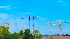 4k Time-lapse of Industrial construction crane with blue sky background Stock Footage