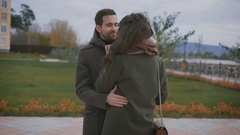 Newly wedded happy couple in warm clothes are embracing and caressing each other Stock Footage