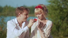 Man feeding his girlfriend with a watermelon Stock Footage