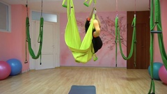 Yogi practice aerial anti gravity yoga on a hammock Stock Footage