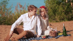 Happy couple in love at a picnic in summer Stock Footage