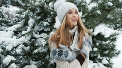 Beautiful woman tries to get warm, winter landscape Stock Footage