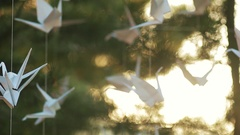 Origami cranes in summer Stock Footage