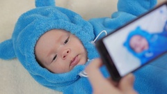 Baby in a funny dress of a toy bear cub. Cute 2-month-old baby boy. Stock Footage
