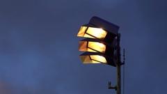 Stadium lights lighting up a sports field, super slow motion. Stock Footage