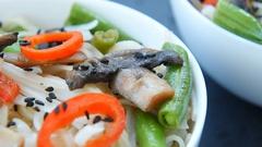Vegetarian roasted teriyaki mushrooms and asparagus soba noodles Stock Footage