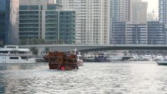 Promenade boat on a canal in the popular district of Dubai Marina. Dubai, UAE Stock Footage