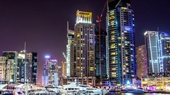 Dubai keeping of yachts at night.Time lapse.Zoom out. Stock Footage