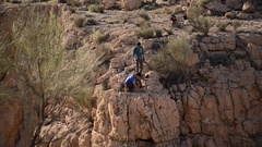 Men prepare to go tightrope walking and slacklining across a canyon. Stock Footage