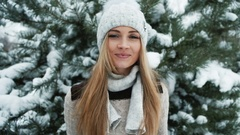 Delightful blonde smiles against background of snow-covered landscape Stock Footage