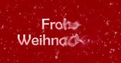 """Merry Christmas text in German """"Frohe Weihnachten"""" formed from dust and turns to Stock Footage"""