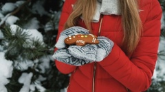 Beautiful woman holds in hand gingerbread little man, winter landscape Stock Footage