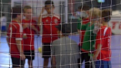 A boys team and coach during a futsal youth soccer football. Stock Footage