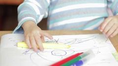 Baby boy draws felt-tip pens Stock Footage