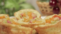 Delicious breakfast in potato basket with sausage and vegetables. Stock Footage
