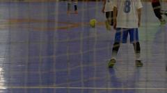 Boys play futsal youth soccer football. Stock Footage