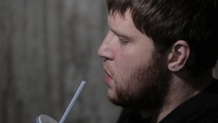 A Man Drinking Soda From A Straw Stock Footage