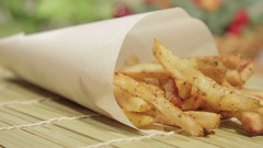 Homemade potato sticks in paper bag Stock Footage