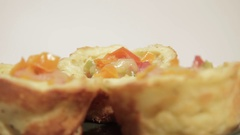 Delicious breakfast in potato tartlet with sausage and vegetables. Stock Footage