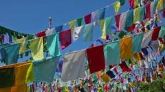 Buddhist prayer flags lungta against sky Stock Footage
