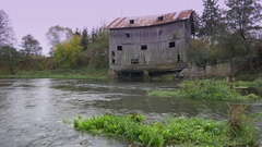 Old haunted house at river bank.  Stock Footage