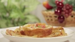 Delicious breakfast in potato tartlet with potato sticks Stock Footage