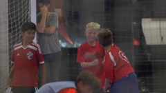 Boys celebrate a goal playing futsal youth soccer football. Stock Footage