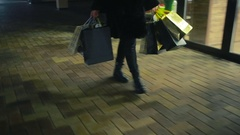 Christmas shopping. girl goes with packages from shop Stock Footage