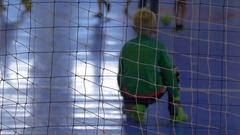 A goalie for futsal youth soccer football, slow motion. Stock Footage