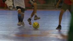 Boys play futsal youth soccer football, slow motion. Stock Footage