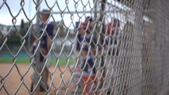Boys play in a little league baseball game. Stock Footage