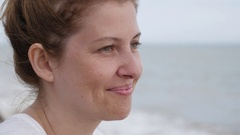 Caucasian blond female on the ocean beach relaxing by sun bath Stock Footage