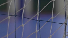 Detail of a goal net during a futsal youth soccer football game, slow motion. Stock Footage
