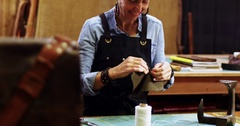 Craftswoman working on a piece of leather Stock Footage