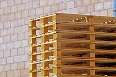 Big stack of wooden pallets for logistic Stock Photos