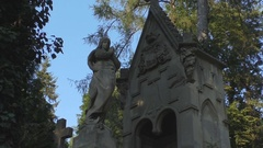 Female sculpture monuments in Lychakiv cemetery open-air museum Stock Footage