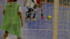 Boys play futsal youth soccer football, slow motion. Stock Footage