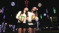 Two Lovely Beautiful Twin Sisters Dancing In The Mood Of Christmas Holding Gift Stock Footage