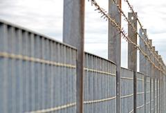Steel anti entry fence with sharp spikes Stock Photos